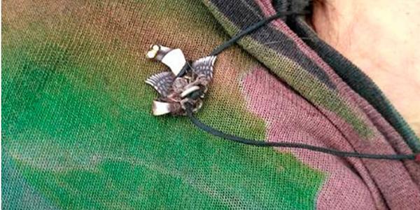 У Кременчуцькому районі знайшли мертвою жінку з кулоном на шиї у вигляді птаха
