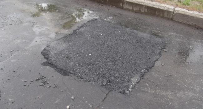 Деньги НЕ в лужу,- начальник УЖКХ об асфальтировании улицы в ливень